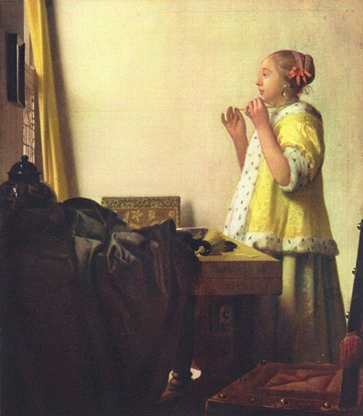 Johannes Vermeer Woman with a pearl necklace 1664