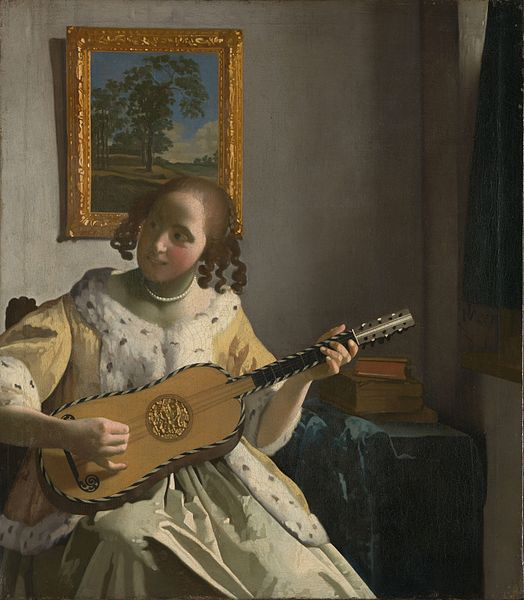 Johannes Vermeer Young woman playing a guitar 1670